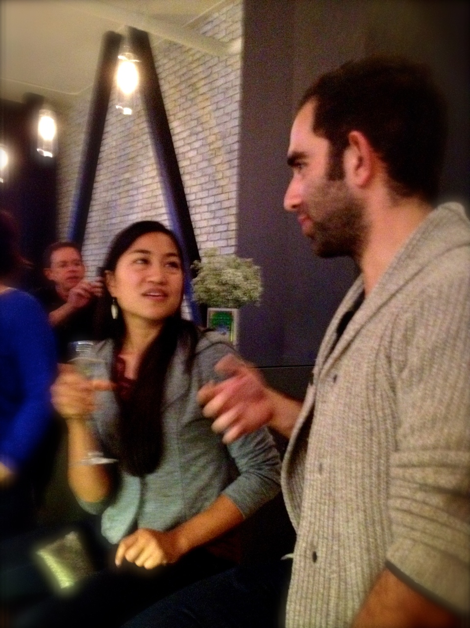 First years, Aileen and Nima, sharing a conversation at October's Happy Hour, Cooking up Community!